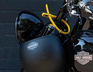 Helmet locked to motorcycle forks with a Hiplok Z Lok Combination lock