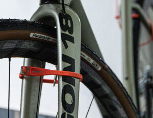 z lok passed through the front wheel and fork of a wet road bicycle
