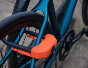 bike rear wheel locked to metal bike rack with d lock