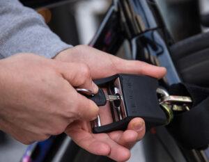 somone locking padlock on chainchain lock locking bikes front wheel