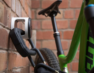 mountain bike locked to wall anchor with a D Lock and Bike Chain Lock
