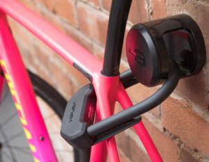bike attached to brick wall using a hiplok ankr wall anchor with a hiplok dx d lock locking bike frame to the wall anchor