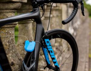 road bicyle locked to a stone bridge using hiplok fx cable bike lock