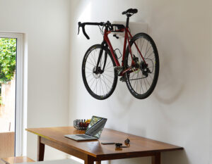 Road Bike in AIRLOK wallhanger over a desk inside a house