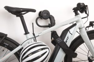 Hiplok ANKR attached to indoorwall locking e bike with EDX chain through front wheel and frame additonal Z LOK securing bike helmet to e bike frame