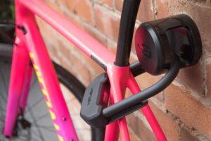 Hiplok ANKR and DX Lock lockimg roadbike to brick wall through rear triange