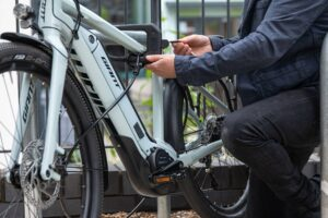 E bike being locked with Hiplok DX d lock with 2mc steel security cable being used to secure the wheels