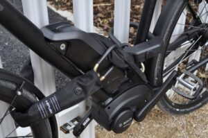 e bike locked to fence with chain lock and d lock