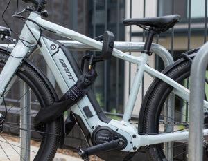 EDX D lock and looped chain locked e bike to metal bike rack