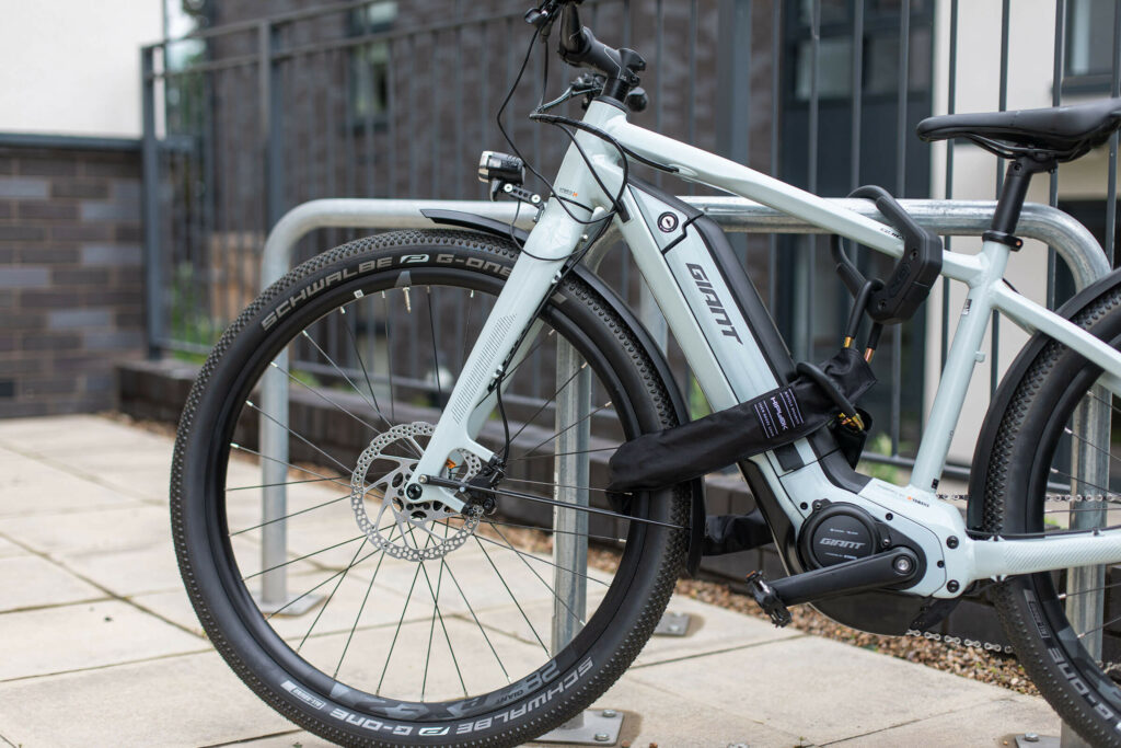 Giant Ebike electric bike being locked outside with a sold secure gold rated Hiplok EDX