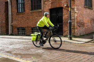 Cyclist wearing reflective Altura Storm Waterproof cycling jacket